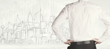 Businessman with drawn city view Stock Image