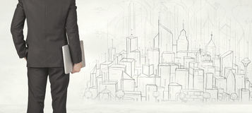 Businessman with drawn city view Stock Images