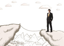 Businessman with drawn edge of mountain Stock Images