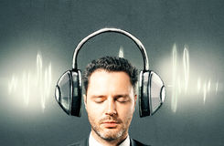 Businessman with drawn headphones Stock Images