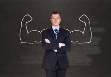 Businessman with drawn powerful hands Stock Photography