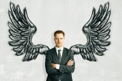Businessman with drawn wings vector illustration
