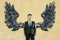 Businessman with drawn wings stock illustration