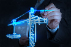 Businessman draws building development Royalty Free Stock Photos