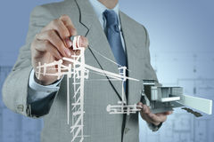 Businessman draws building development Royalty Free Stock Image