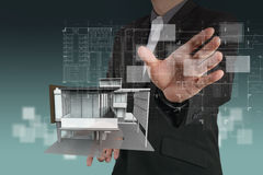 Businessman draws building development Stock Images