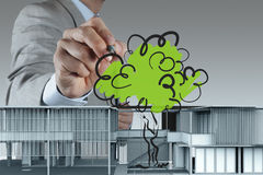 Businessman draws building development Royalty Free Stock Images