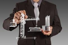 Businessman draws building development Royalty Free Stock Image