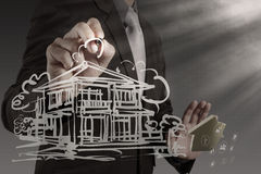 Businessman draws building development Stock Photos