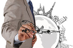 Businessman  draws dream travel around the world Royalty Free Stock Images