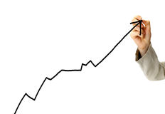Businessman draws a graph Stock Image