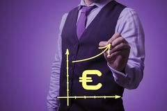 Businessman draws the growth of the euro Royalty Free Stock Images