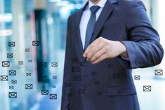 Businessman draws letters. stock image