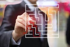 Businessman draws the solution to the maze . Businessman draws the solution to the maze on the virtual screen Royalty Free Stock Photos