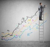 Businessman draws statistics Stock Photos