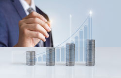 The businessman draws the statistics of financial growth. Stock Photos