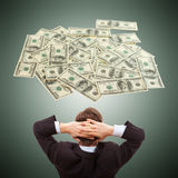 Businessman dreaming about money cash, dollars, Royalty Free Stock Photos