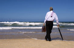 Businessman dreaming of retirement freedom on a tropical beach, copy space Stock Image