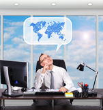 Businessman dreaming about travel Royalty Free Stock Images