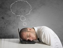 Businessman dreams while sleeping Royalty Free Stock Photo