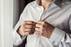 Businessman dress shirt. The man in the white shirt in the windo Stock Photography