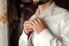 Businessman dress shirt. The man in the white shirt in the windo Stock Photo