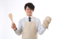 Businessman dressed in the apron Stock Image
