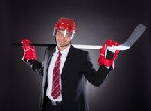 Businessman Dressed As Hockey Player Royalty Free Stock Photos