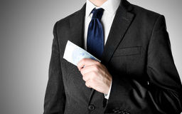 Businessman Dressed in Suit Holding Twenty Euro Bills. Businessman with blue tie holding twenty euro bank notes Stock Photos
