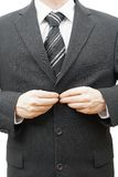 Businessman dressing up Stock Images