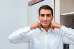 The businessman dressing up for work Royalty Free Stock Photo