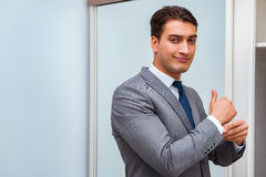 The businessman dressing up for work Royalty Free Stock Image
