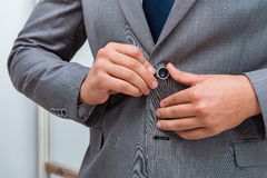 The businessman dressing up for work Stock Images