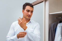 The businessman dressing up for work Royalty Free Stock Images
