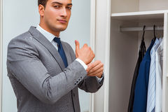 The businessman dressing up for work Stock Photo