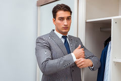 The businessman dressing up for work Stock Photos