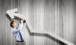 Businessman with drill Royalty Free Stock Images