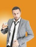 Businessman drink alchool Photo stock