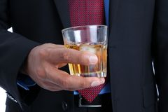 Businessman with a drink in his hand Royalty Free Stock Photos
