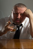 Businessman drinking alcohol and smoking cigarette Royalty Free Stock Photography