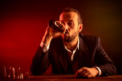 Businessman Drinking a Beer Royalty Free Stock Photography