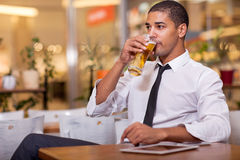 Businessman drinking beer Royalty Free Stock Image