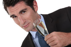Businessman drinking champagne. Stock Photography