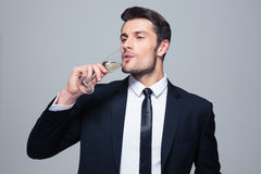Businessman drinking champagne Royalty Free Stock Photo