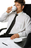 The businessman drinking coffee Stock Photography
