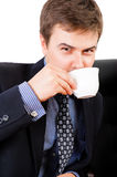 Businessman drinking coffee Royalty Free Stock Images