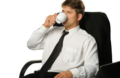 The businessman drinking coffee Royalty Free Stock Photo