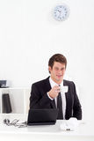 Businessman drinking coffee Royalty Free Stock Image