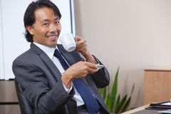Businessman Drinking Coffee Royalty Free Stock Photos