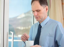 Businessman drinking coffee Royalty Free Stock Photo